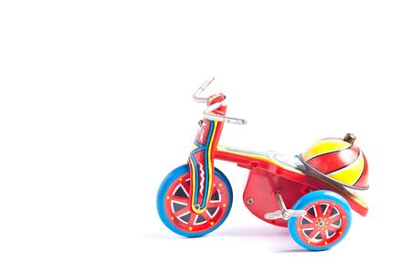 antique tricycle: antique tin toy  tricycle on white background Stock Photo