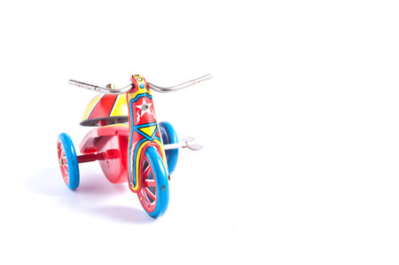 tricycle: antique tin toy  tricycle on white background Stock Photo