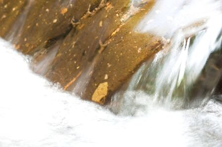 swiftly: abstract of a swiftly moving stream Stock Photo