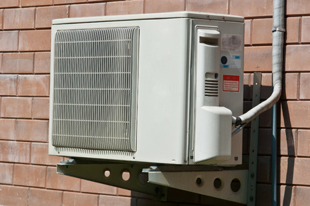 condenser: Air condition condenser unit hanging on wall