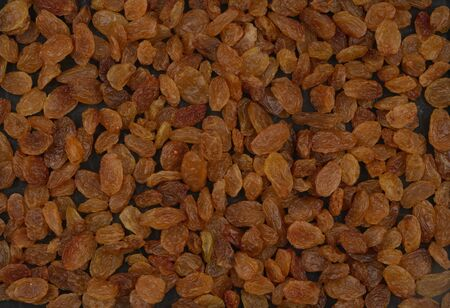 Organic Raisins, yellow is the highest grade. Delicious background or wallpaper. Imagens
