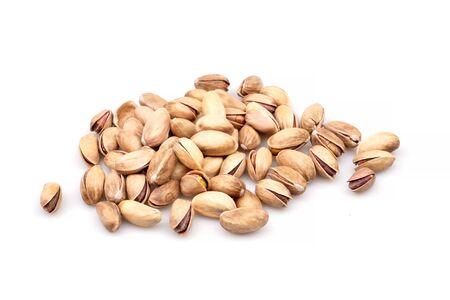 Tasty organic pistachio nuts, isolated on white background