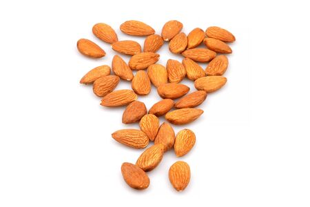 Organic Almonds on a white background. Pile of selected almonds close up
