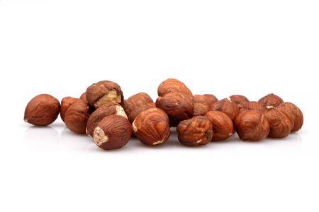 Fresh and Organic unpeeled hazelnuts on white background