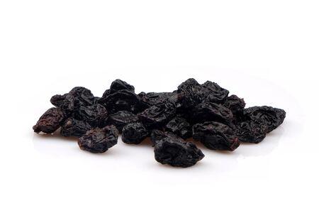 Organic Black raisins on white background