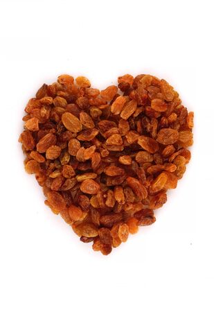 A scattering of organic raisins in the form of heart - isolated object