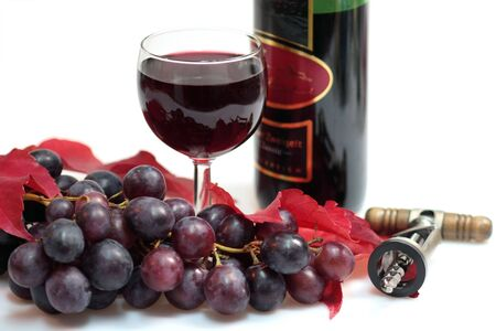 Red wine in a glass with grapes, vine leaves, cork screw and wine bottle on white background Stock Photo - 3938015
