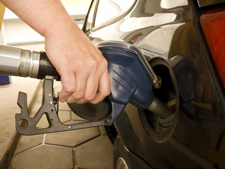 Hand holding a fuel pump at a gas station Stock Photo - 4036786