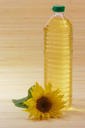 cooking oil: Cooking oil in a plastic bottle with sunflower blossom