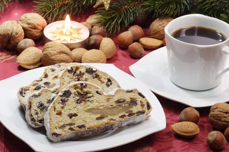 Sliced stollen on a plate with a cup of coffee