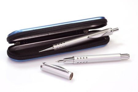 ballpen: Silver ballpen and rollerball pen in a blue case over white background