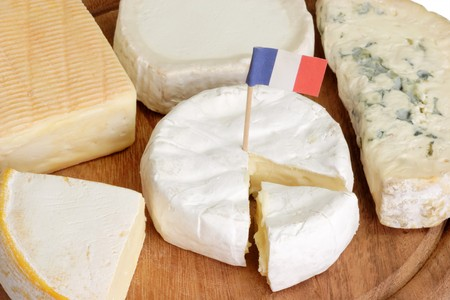 Different sorts of french soft cheese on a plate