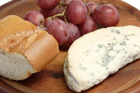 bread mold: Mold cheese with grapes and bread Stock Photo
