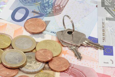 lockbox: Euro bills and coins with key of a lockbox