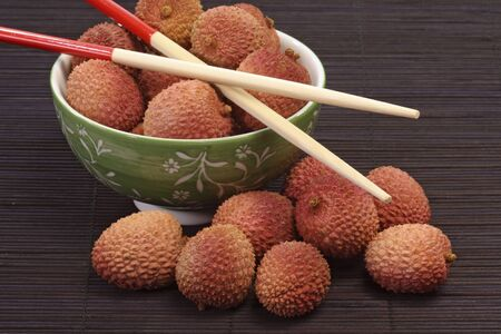 leechee: Litschis in a bowl on decorative background Stock Photo