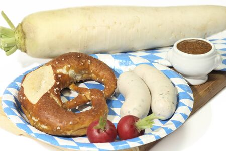 veal sausage: Bavarian veal sausage with mustard, pretzel and radish Stock Photo