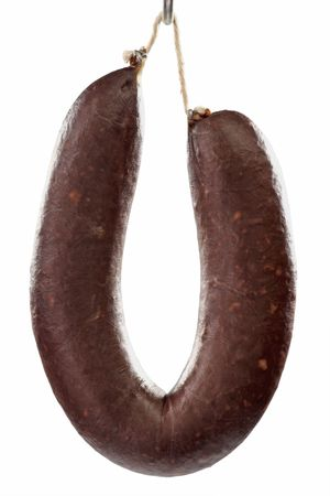 Home-made blood pudding on a hook - isolated over white background