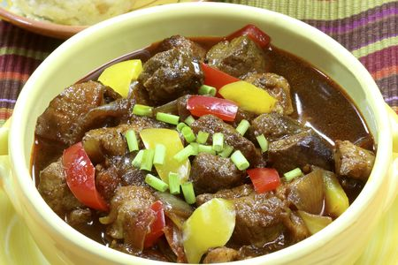 Goulash in a pot with dumplings