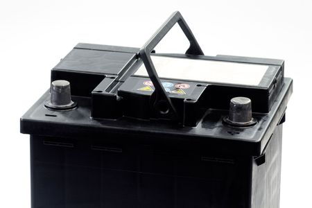 12 volt car battery with electrical leads clipped on to the terminals - isolated over white