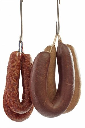 Different sorts of home-made sausages - isolated over white background