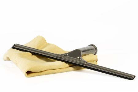 Utensils for cleaning windows over white background