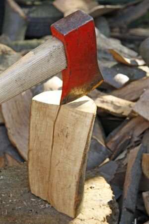 chipping: Chipping firewood with an axe
