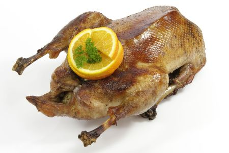 Crunchy fried goose with orange on white background