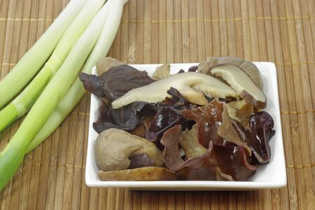 Assorted asian mushrooms in a bowl photo