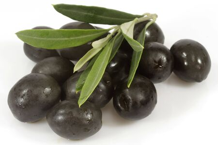 Black olives with olive branch on white background photo