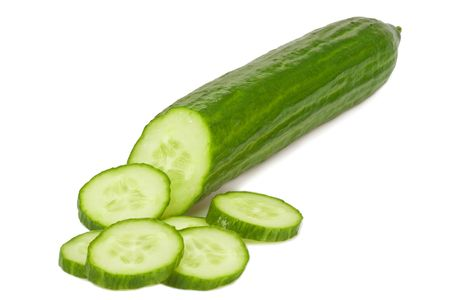 Closeup of a sliced cucumber - isolated on white background