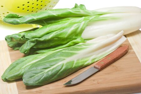 Closeup of fresh silverbeet on a wooden plate Stock Photo