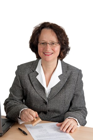 Mature adult woman stamping a form Standard-Bild