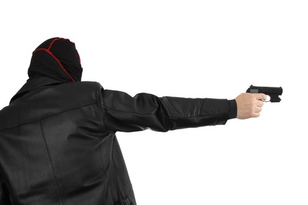 Disguised killer with handgun - isolated on white photo