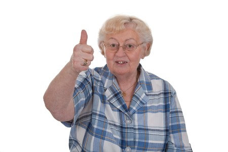 Elderly woman showing thumbs up isolated on white Stock Photo