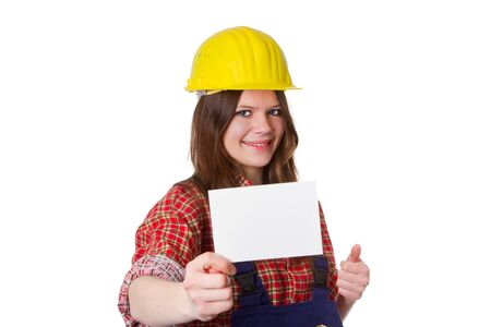 workwoman: Young craftswoman holding a white card - isolated