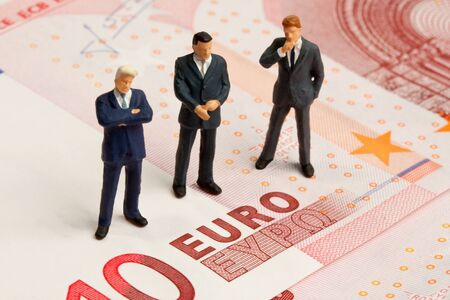 Three toy train figures on a ten euro note photo