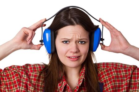 Young woman with hearing protectors - isolated photo