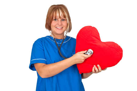 Young nurse with stethoscope and red heart - isolated Stock Photo - 10600773