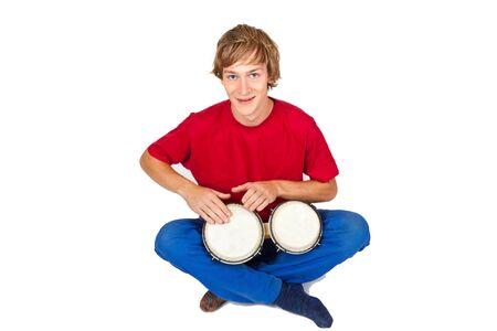bongos: Young man playing bongos - isolated on white