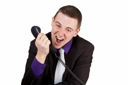 conversational: Young businessman screaming into a phone - isolated