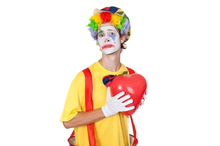 Young man as clown with red balloon Stock Photo - 14333132