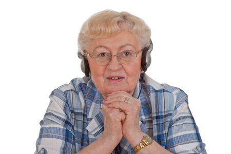 Elderly woman listening to music - isolated photo