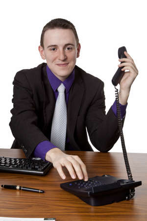 Young businessman dialing telephone number - isolated Stock Photo - 14780807