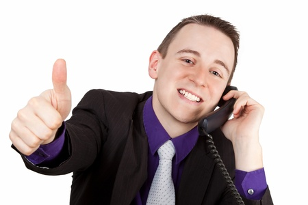 Junger Geschäftsmann am Telefon zeigt Daumen hoch - isoliert Standard-Bild - 14780800