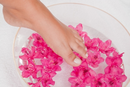 Young woman taking a footbath Stock Photo
