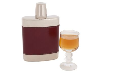 hip flask: Hip flask with schnapps in a glass