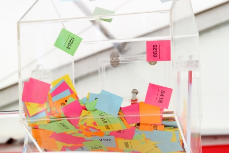 Lottery wheel with multicoloured tickets Standard-Bild
