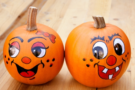 Painted pumpkins on a wooden tabel