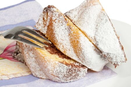 powdered sugar: Wedges of marbel cake on a plate with fork Stock Photo