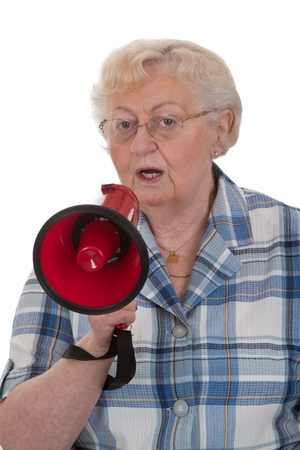 Elderly woman speaking into megaphone - isolated photo
